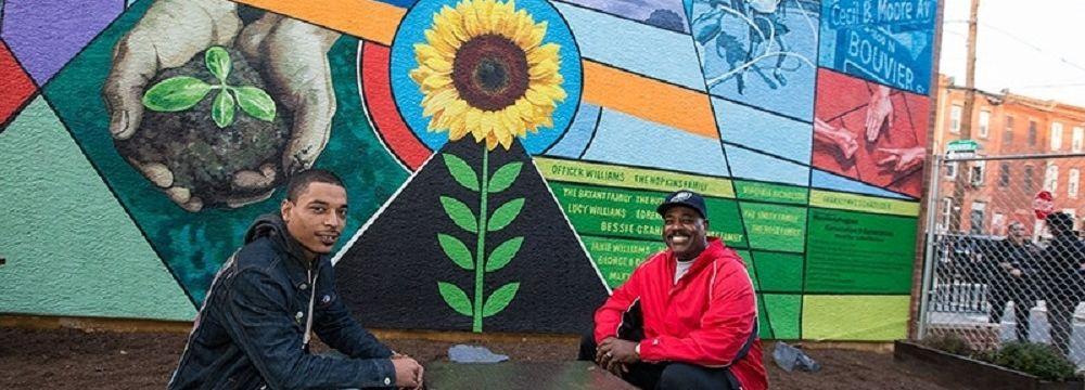 Men in front of Bouvier St. mural